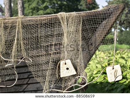 Old fishing boat with net, Kurzeme county, Latvia, Europe - stock photo