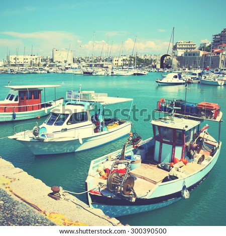 Old fishing boats and yachts in Heraklion port, Greece. Instagram style filtered image - stock photo
