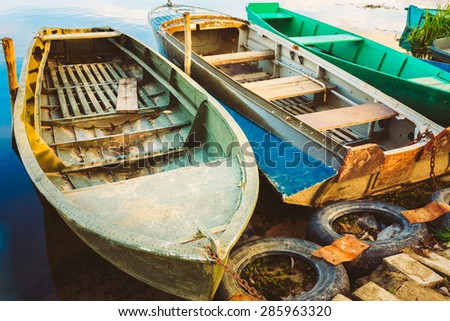Old Fishing Boats In River. Rowboat, Russian Nature At Sunset - stock photo