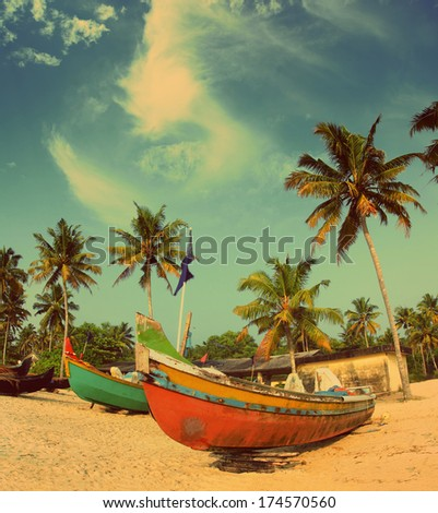old fishing boats on indian beach - vintage retro style - stock photo