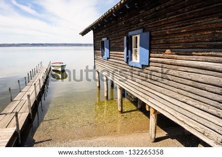 old fishing hut at a lake - stock photo