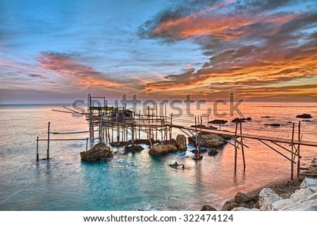 old fishing hut trabocco, the typical wooden palafitte in the sunrise of the Mediterranean sea coast in Chieti, Abruzzo, Italy
