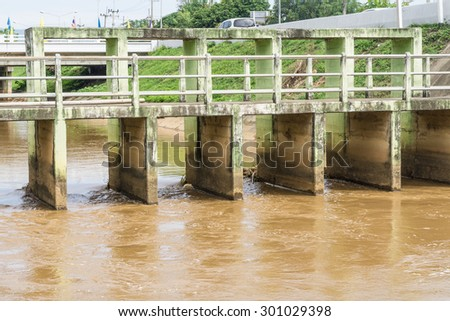 Old Floodgate on river - stock photo