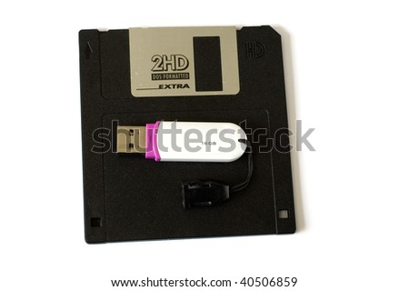 Old floppy disc and modern memory card