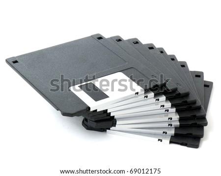 Old floppy disks isolated on white background - stock photo