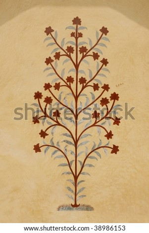 Old flower painting on the Amber Fort temple wall, Rajasthan, India