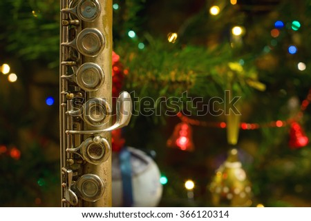 Old flute near a New Year tree, Christmas concept