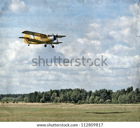 Old flying biplane, retro aviation background