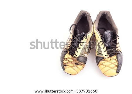 Old football shoes isolated on white background - stock photo