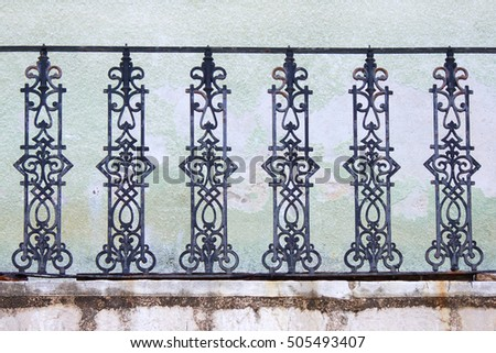 Old forged fence on a balcony