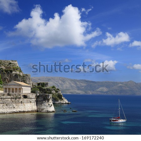 Old Fort and Hellenic Temple in Harbor of Corfu, Greece - stock photo
