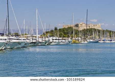Old fort Carre and Yachts moored in Antibes. Antibes is a resort town in the Alps-Maritimes department in southeastern France between Cannes and Nice, Cote d'Azur. - stock photo
