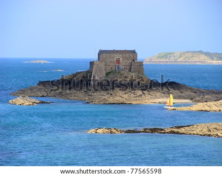 Old fortress off the Emerald Coast at St. Malo, France - stock photo
