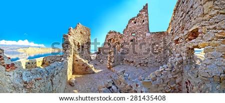 Old fortress ruins on Pag island and bridge panoramic view, Dalmatia, Croatia - stock photo