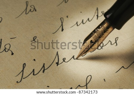 old fountain pen on paper handwritten - stock photo