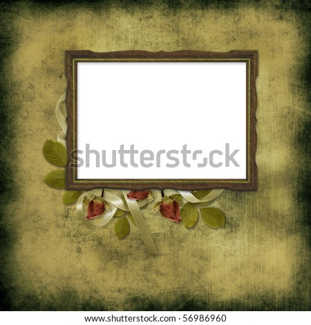 old frame over grunge wallpaper and roses - stock photo