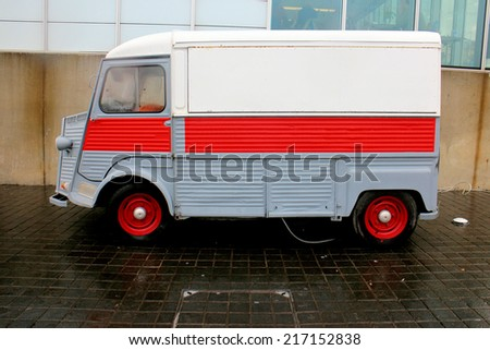 Old french delivery truck on a parking lot - stock photo