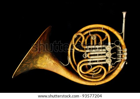 old french horn isolated on the black background - stock photo