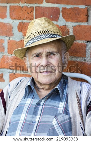 Old, friendly man with straw hat/grandfather/man - stock photo