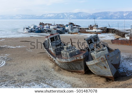 Old frozen ship on the bank of Olkhon island on siberian lake Baikal, Irkutsk region, Russia