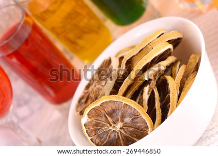 old fruits on white plate and juice close up - stock photo