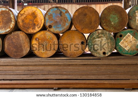 Old fuel tank  on wooden - stock photo