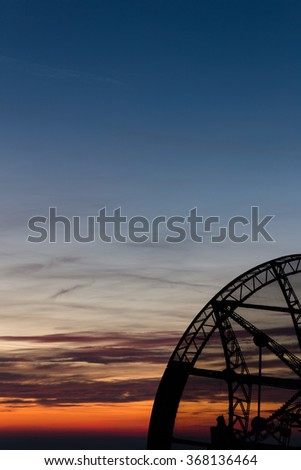 old functional radio telescope at dusk
