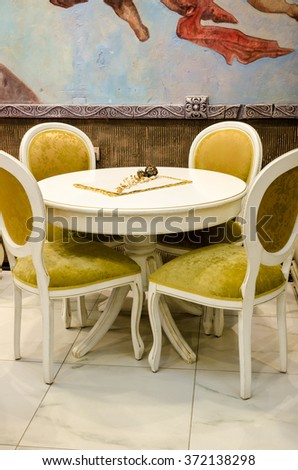 old furniture table and chairs - stock photo