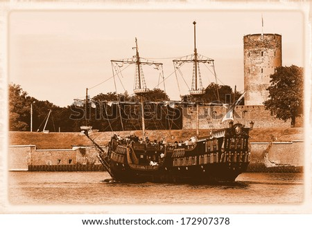 Old Galleon and Wisloujscie Fortress in port of Gdansk, Poland.- styling at an old photograph