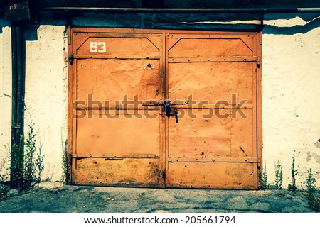 old garage gate - stock photo