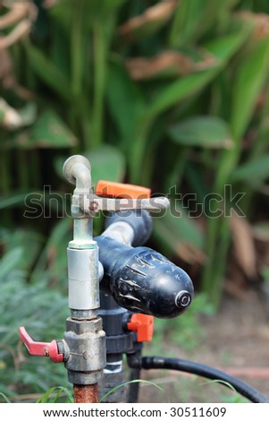 Old garden sprinkler - stock photo