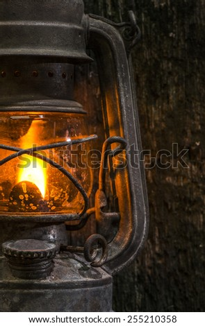 Old gas lantern on wood at darkness