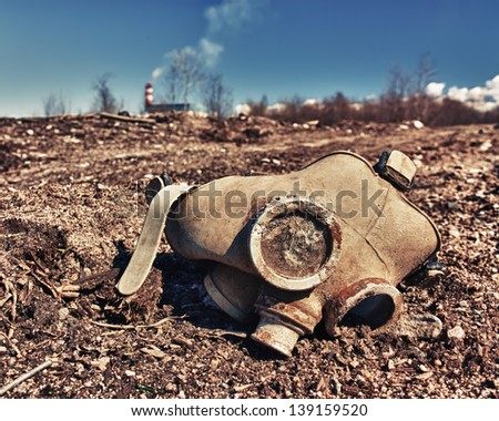 Old gas mask lies on the road. - stock photo