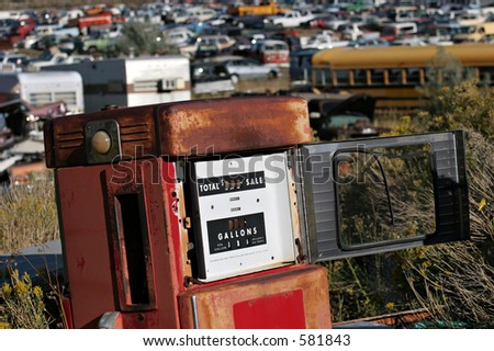 old gas pump, abandoned at a junkyard - stock photo