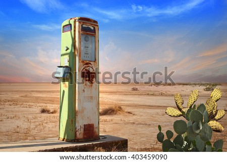 Old Gas Pump in Desert - stock photo