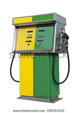Old gas pump in the colors yellow and green - stock photo