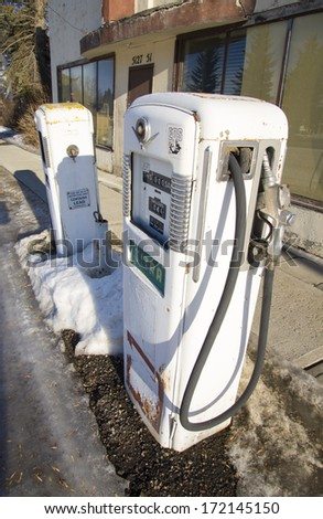 Old gas pumps at an abandoned gas station - stock photo