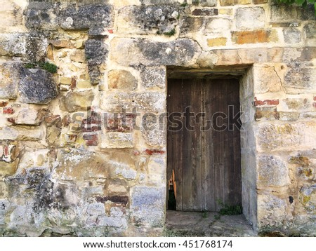 old gate in an abbey wall - stock photo