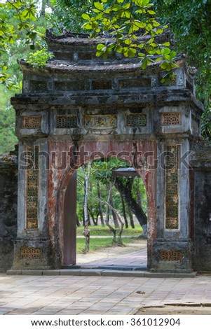 Old gate in Imperial Minh Mang Tomb in Hue - stock photo