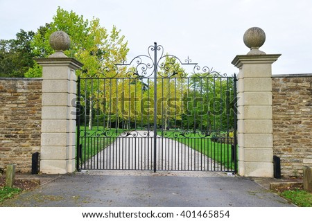 Old Gated Entrance and Driveway of a Country Estate - stock photo