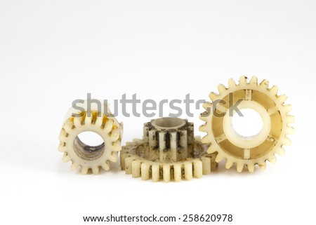Old gear plastic on white background - stock photo
