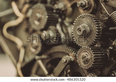 Old gears in black oil
