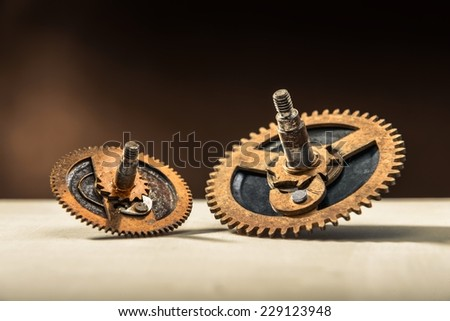 Old gears on table in different sizes