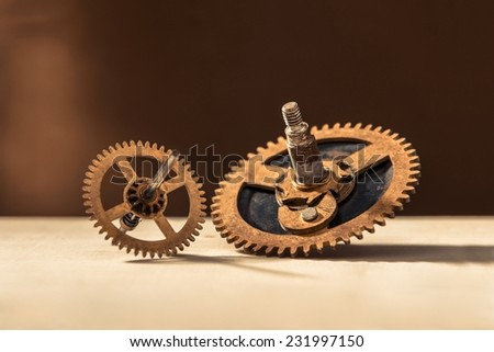 Old gears on table in different sizes - stock photo