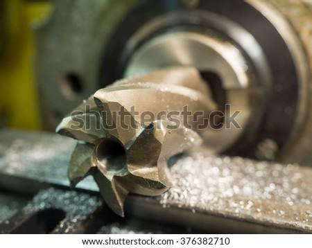 Old geen  milling machine, closeup, metalworking  - stock photo