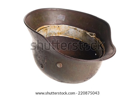 Old German fascists helmet of times of the second Great world war on a white background with clipping path.