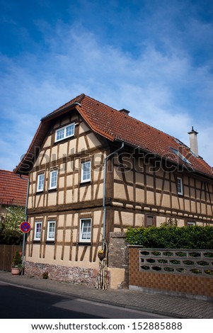 Old German house in the city of Frankfurt am Main, Germany. This picture is taken with CPL filter and is processed in 16-bit sRGB mode. - stock photo