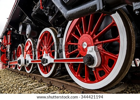 Old german steam locomotive, built in 1940, in a museum. The heaviest locomotive, 85 tons, that circulated in Romania during the Second World War. Detail and close up of huge wheels. - stock photo