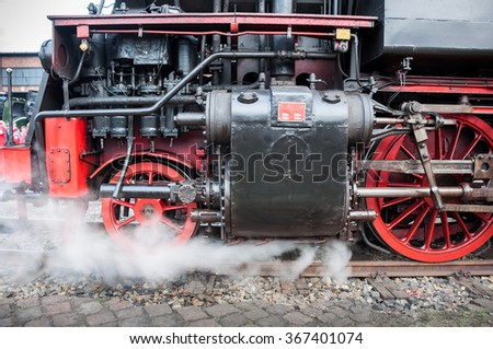 Old german steam locomotive. Detail and close up of huge wheels. - stock photo