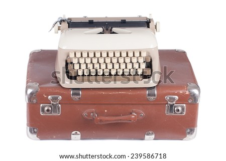 Old german type writer on an old suitcase isolated on white - stock photo